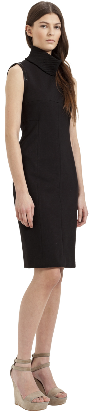 This black sheath dress by Akris Punto has a detachable knitted cowl neck and patent leather piping.