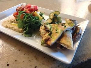 Chef Douglas Katz's tomato and eggplant salad with house-made naan and pickled cucumber salad.