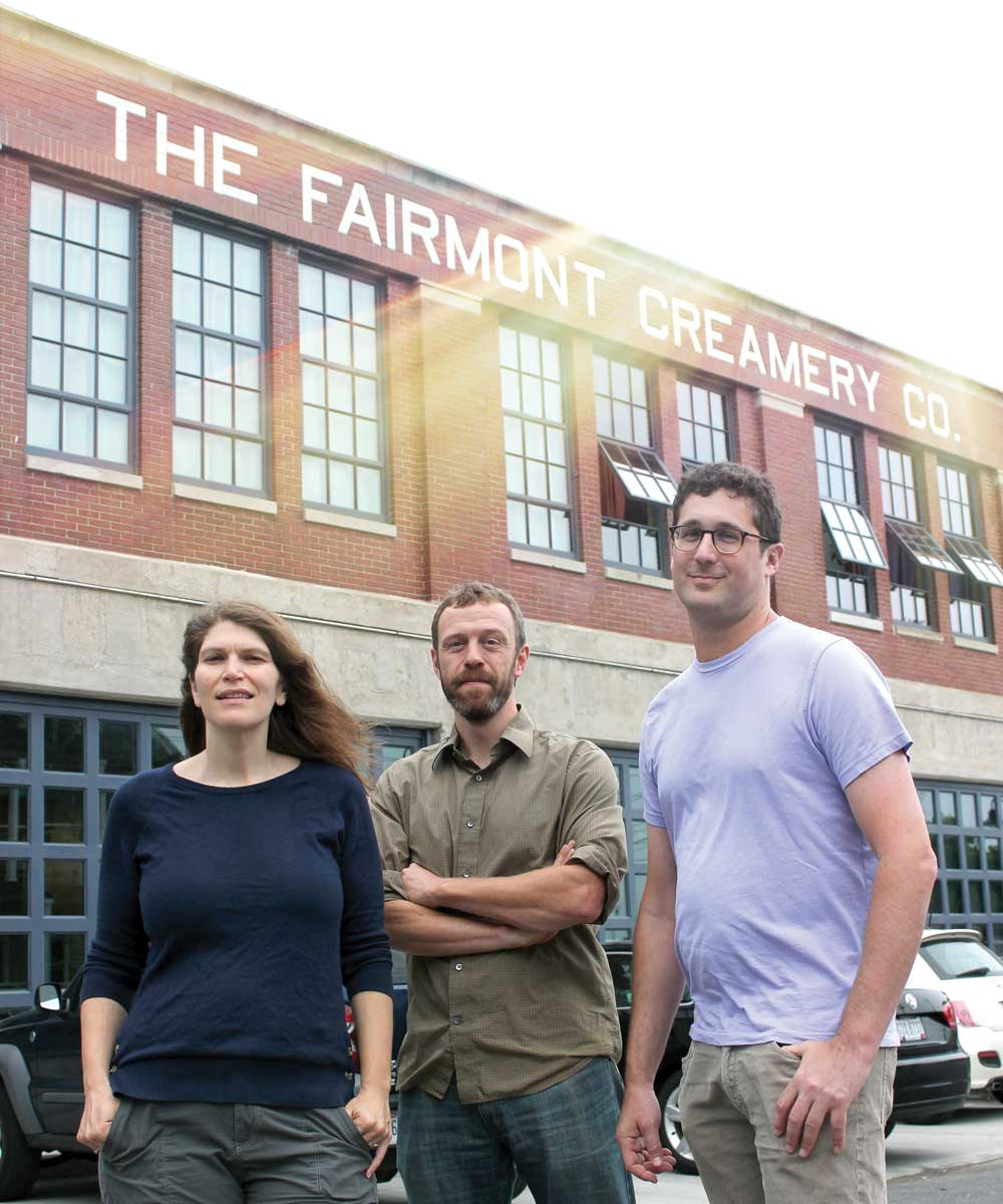 From left, Naomi Sabel, Ben Ezringa and Josh Rosen stand in front of Fairmont Creamery, which they transformed from a '30s-era factory to a mixed-use development that includes apartments, business offices and a gym. Right: An earlier look at Fairmont Creamery, which ceased operations in the 1970s.