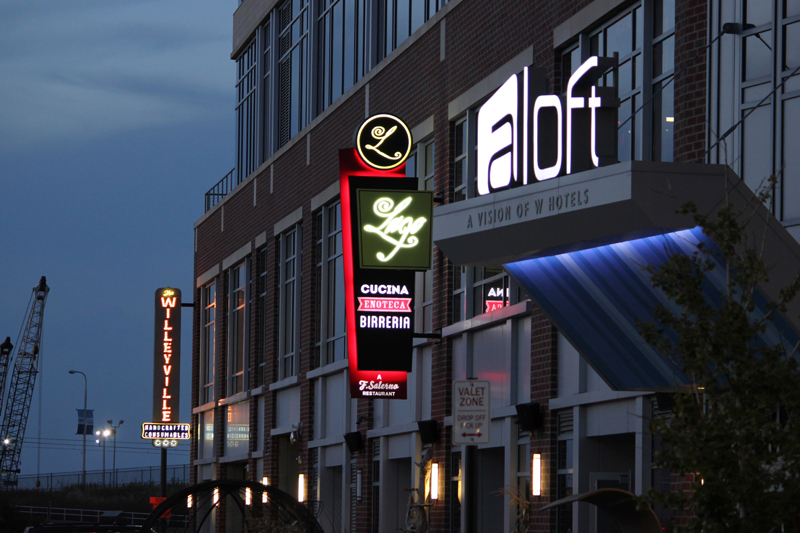 Flats East Bank Phase I businesses like Lago East Bank and Aloft Downtown Cleveland add to the district's neighborhood feel.