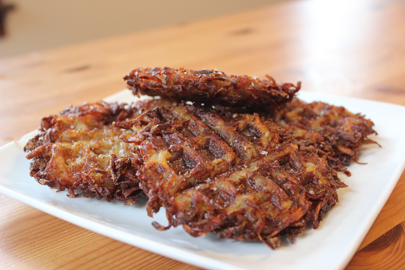 Schmaltz's waffle iron-pressed latkes are designed to keep toppings like sour cream and applesauce from running off.