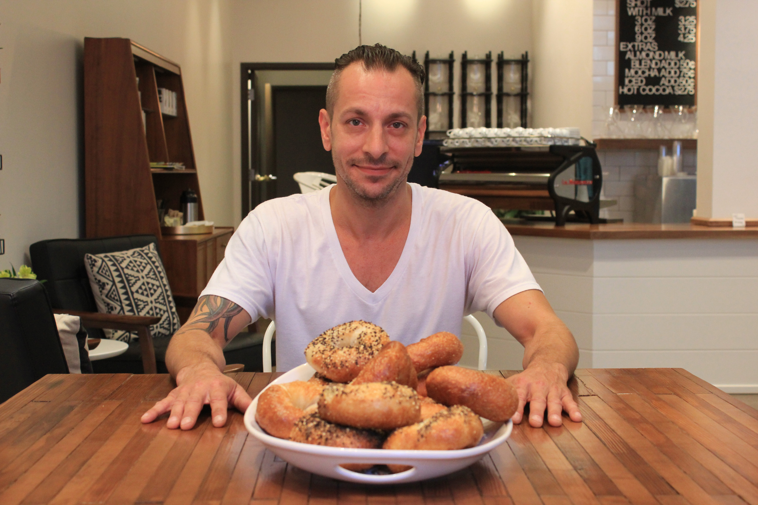 Dan Herbst of Cleveland Bagel Co. presents a variety of his bagels, including plain, everything, sea salt, sesame seed and poppy seed. Pour Cleveland in downtown's 5th Street Arcades is one of several locations throughout the region where people can find Cleveland Bagel Co. bagels.