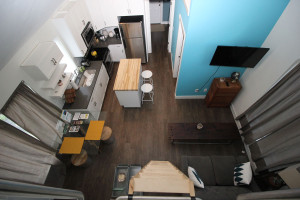 Looking down from the loft bedroom, one can see the living room, dining room and kitchen in the Detroit Shoreway Community Development Organization's Tiny House.