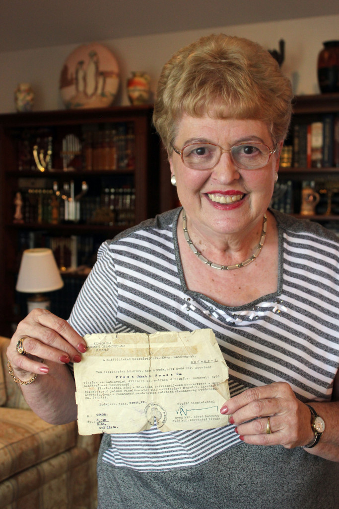 Eva Kahana, a Holocaust survivor and Case Western Reserve University professor, shares a Swedish Schutz-Pass, meant to protect Jews during the Holocaust, in the living room of her University Heights home.