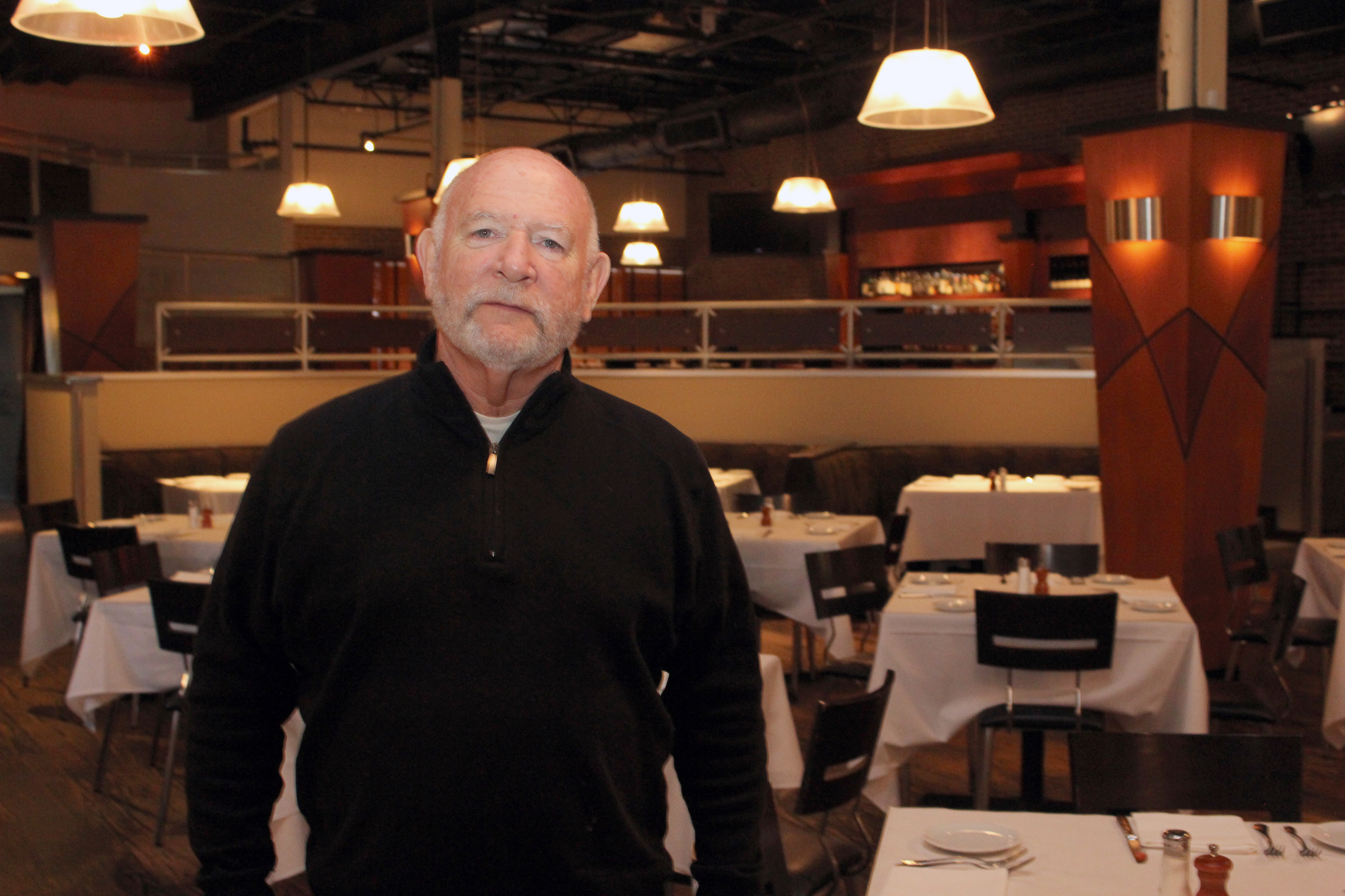 Brad Friedlander, one of four partners in Red Restaurant Group, stands in the dining room at Moxie the Restaurant in Beachwood, which he says has occasionally featured Asian dishes on its menu over the years.