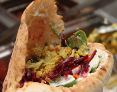 A falafel pita is prepared at Seth Bromberg's Raving Med in downtown Cleveland's Playhouse Square district.