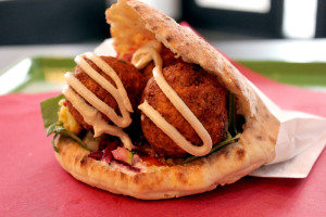 A falafel pita that features spinach, Israeli salad, pickled beets, pickled cauliflower, pickled carrots, tzatziki and tahini, also from Raving Med.