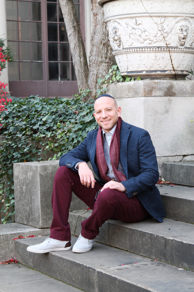 Joe wears a scarf by J.M. Dickens, wool vest and jacket by Eleventy, shirt by Canali and burgundy pants by Paige, all from Kilgore Trout