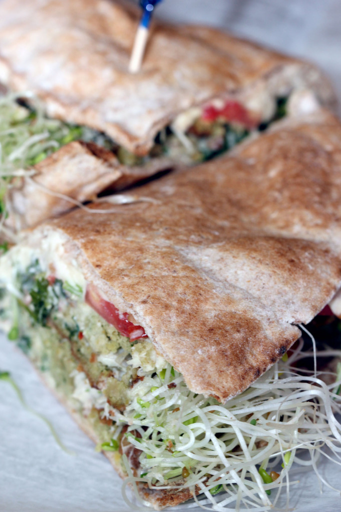 Julie's Tabbouleh, a falafel sandwich with hummus, mixed bell peppers, tabbouleh, sunflower seeds, tahini and sprouts.