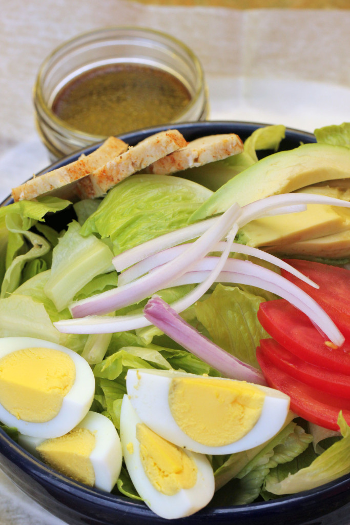 Munch's Cobb salad with eggs, tomato, chicken and avocado, served with a house-made balsamic vinaigrette.