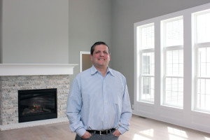Rodney Simon, owner of Simcon Homes, which would build homes designed by Donnelly Eber Architects should the Shaker Design Competitions projects get funded, stands in a model home in the Sterling Lakes development of Pepper Pike.