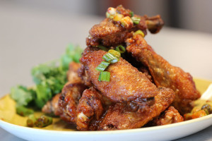 Thai caramel wings with cilantro.