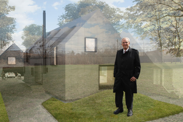 Shaker Heights Mayor Earl M. Leiken stands in front of a vacant lot in the southern Moreland neighborhood. Superimposed on the lot is a rendering from Donnelly Eber Architects in New York City, one of the winning firms in the Shaker Design Competition aimed at re-imagining the neighborhood.