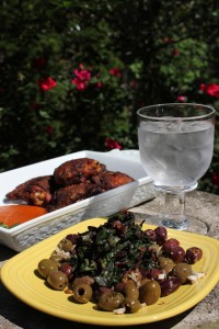 Chef Douglas Katz's Swiss chard with onions, served on a bed of olives, and his Harissa roasted chicken, served with a purée made during the final step of the recipe (see below).