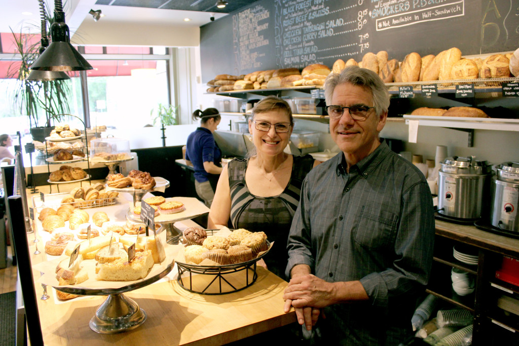 Tatyana Rehn and John Emerman, co-owners of The Stone Oven, stand behind the pastry counter at the Cleveland Heights location.