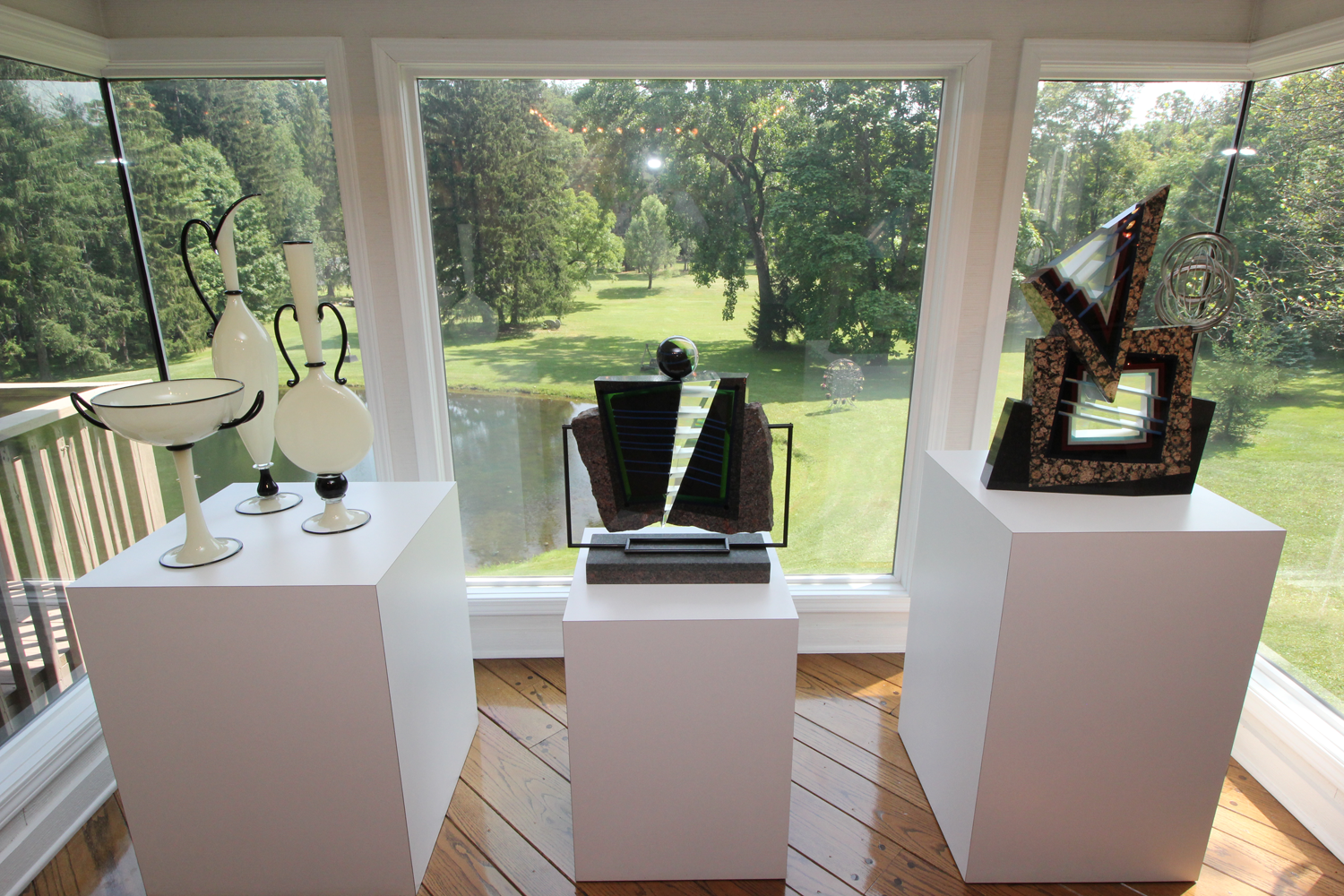 "From left, ""Ivory and Black"" by Dante Marioni, 1996, three-part blown glass group; ""Vetro Muralis"" and ""Contrapuntal,"" both sculptures by William Carlson."