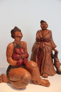 """Fleur d'Alose"" and ""Beautiful Bev with Bow Wow,"" clay sculptures from Cynthia Polster's ""Women of Significance"" series."