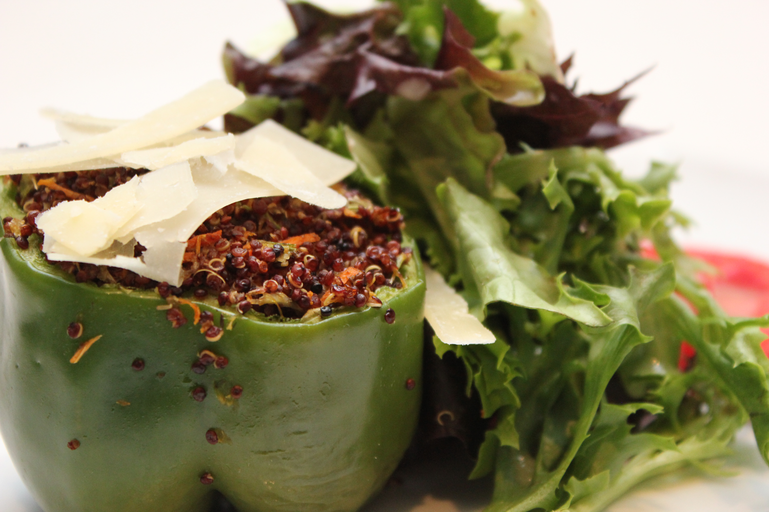 Provenance Café's red quinoa, wild mushroom and parmesan stuffed pepper with local greens and tomatoes.