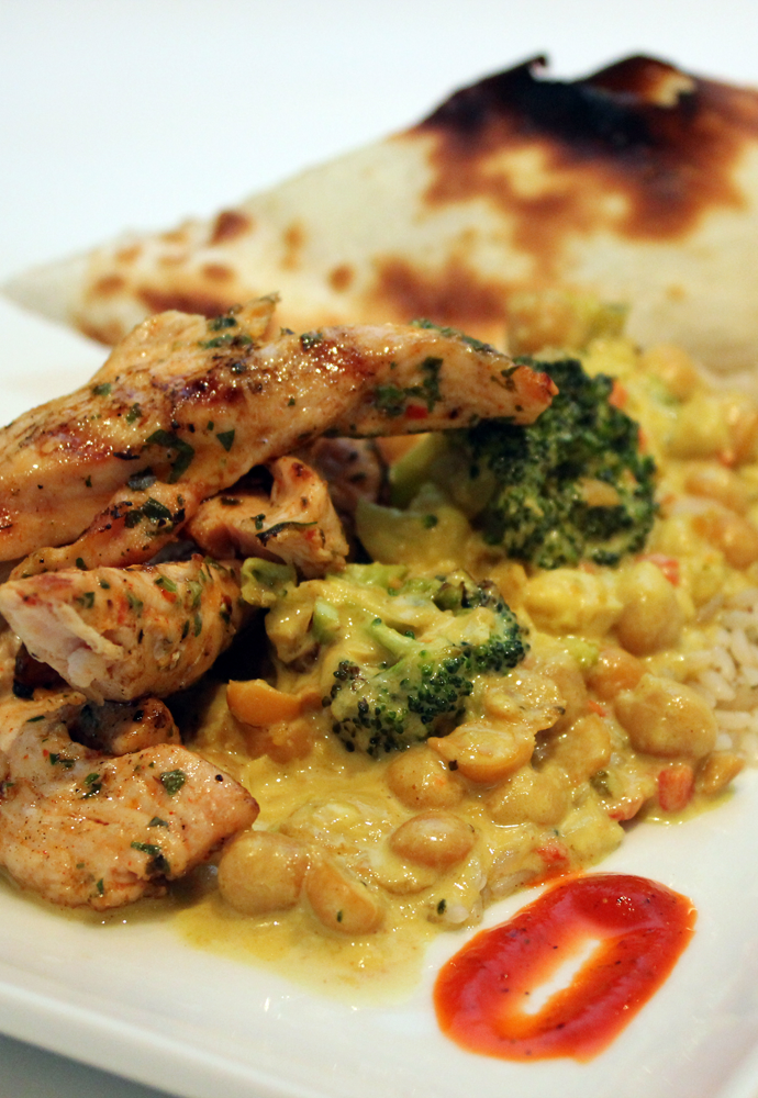 marinated grilled chicken with claybread, vegetable curry and red pepper sauce