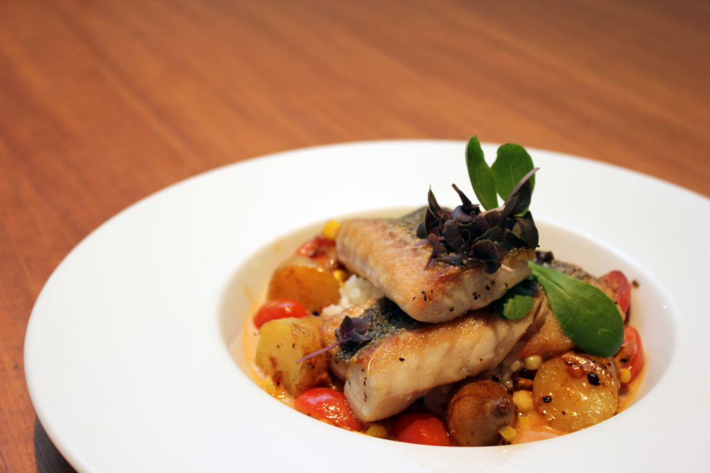 Bass with corn, peppers, marble potatoes, cilantro, toasted cashew and coconut broth is a Douglas Katz creation available at Cleveland Museum of Art's Provenance.