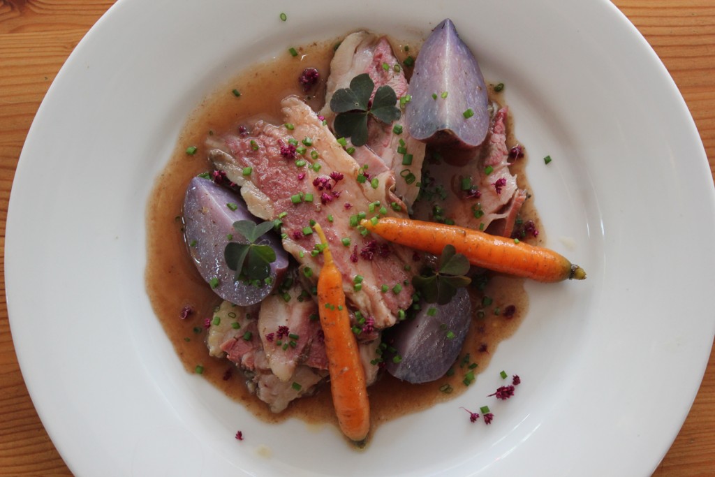 Umansky suggests using odd numbers when plating dishes, as he did with three slices of meat and a total of five colorful carrots and potatoes.