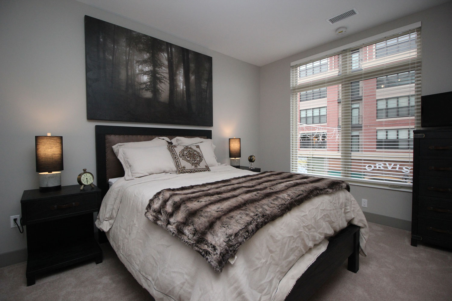 One of the bedrooms in Crocker Park's two-bedroom model apartment .