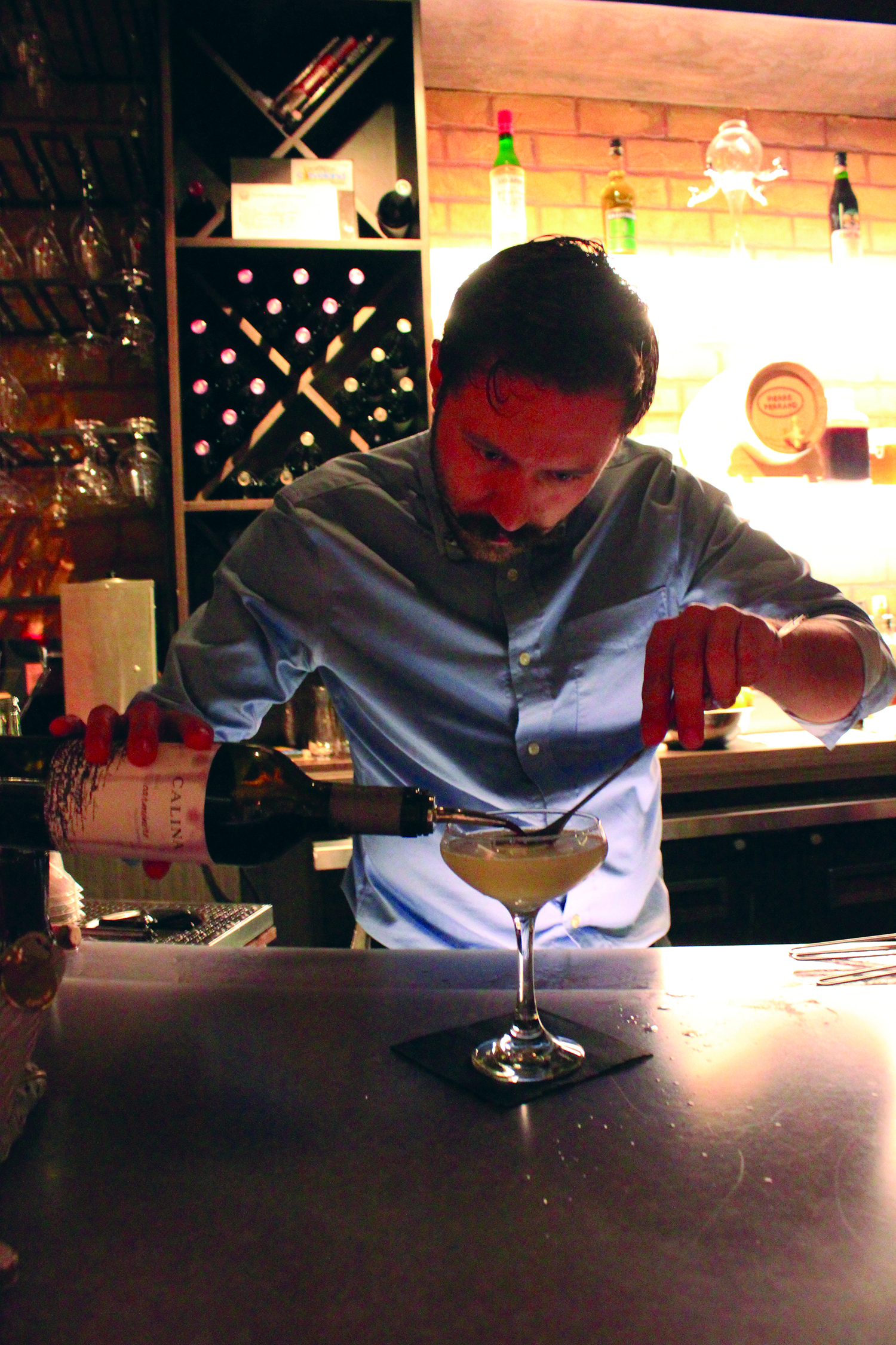 : Beverage director Joseph Frederickson makes Society Lounge's most popular drink, the Fourth Street Sour.