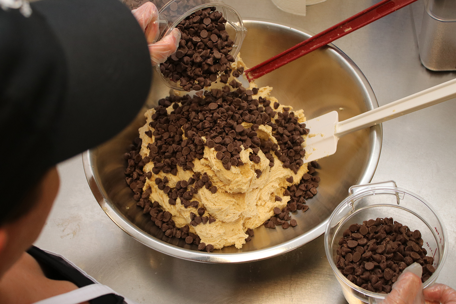 "Pollock prefers to use full-size chocolate chips so that Dough Street's cookie dough has ""full flavor."""