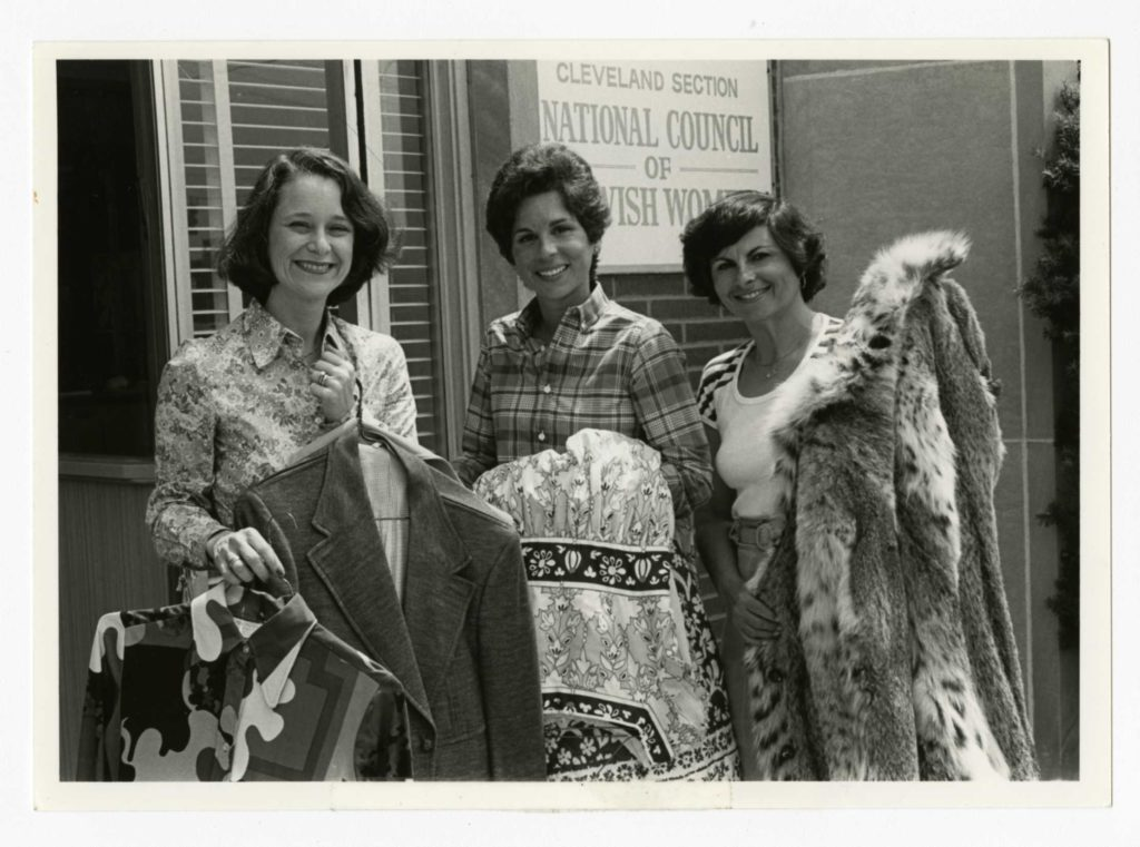 From left, Carol Abrams, Judy Rand and Millie Korman show off their Designer Dress Day finds in 1980 in front of the NCJW/Cleveland building on Lee Road in Shaker Heights, where the event was held that year. Western Reserve Historical Society